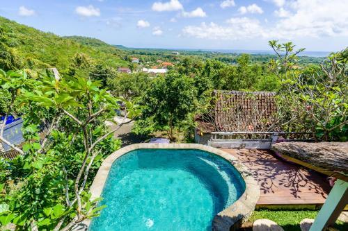 Uma vista da piscina em Sunhouse, Mandala Village ou nas proximidades