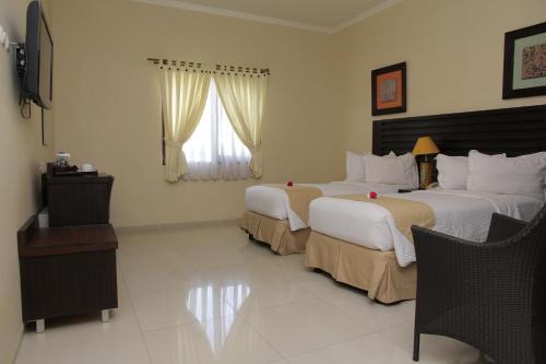 Tempat tidur dalam kamar di Bahamas Hotel & Resort Belitung