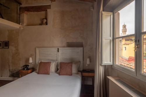 Letto o letti in una camera di Residenza La Musa Amarcord
