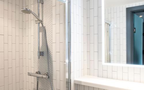 A bathroom at Point A Kensington Olympia