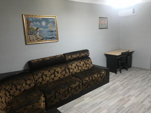 Uma área de estar em Ganjlik Mall Apartament
