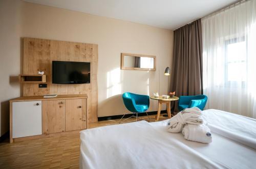 Телевизор и/или развлекательный центр в Rogner Bad Blumau