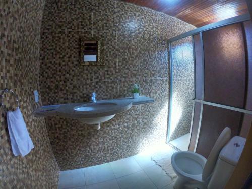 Um banheiro em Calú Hostel