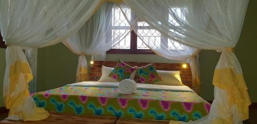 A bed or beds in a room at Airport Link Guest House