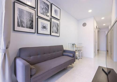 A seating area at 2br Raffles Executive
