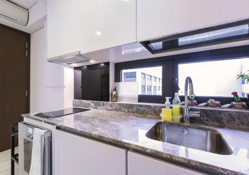 A kitchen or kitchenette at 2br Raffles Executive