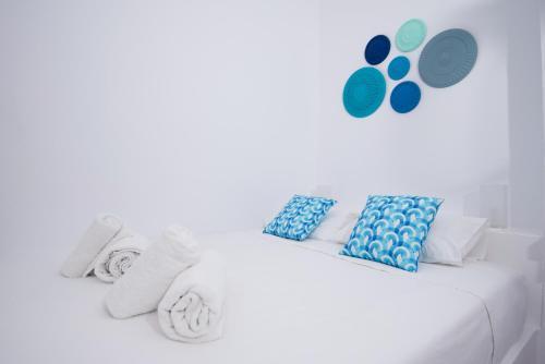 Un ou plusieurs lits dans un hébergement de l'établissement Villa Markezinis