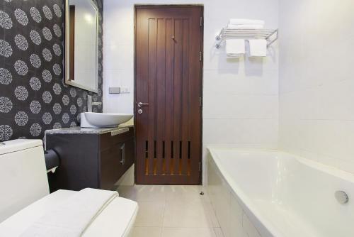 A bathroom at Bally Suite Silom