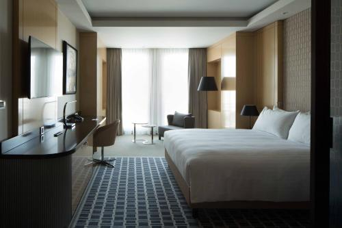 A bed or beds in a room at Skopje Marriott Hotel