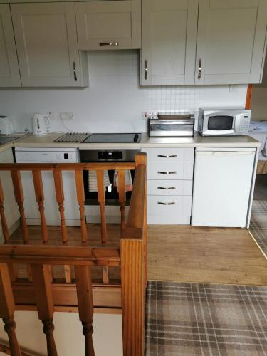 A kitchen or kitchenette at Greannan Upper Self Catering Apartment
