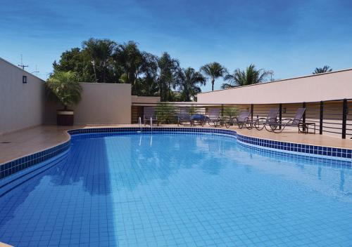 The swimming pool at or near Garden Hotel