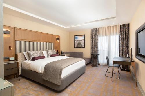 A bed or beds in a room at Almira Hotel Thermal Spa & Convention Center