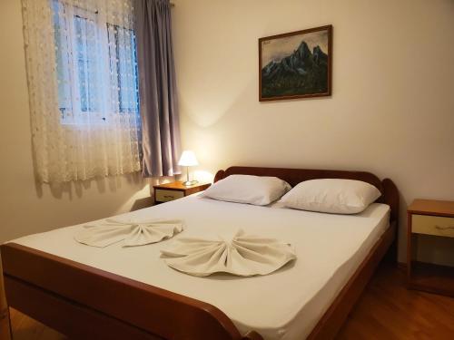 Voodi või voodid majutusasutuse Egon Apartments toas