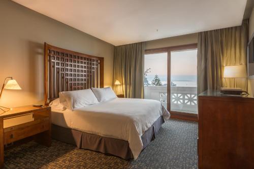 A bed or beds in a room at Enjoy Viña Del Mar