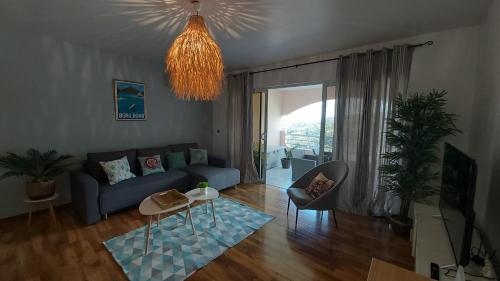 Uma área de estar em Grand appartement Vue Mer Papeete