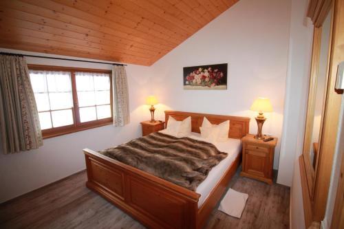 Ein Bett oder Betten in einem Zimmer der Unterkunft Hotel & Restaurant Grüner Baum - Die Grüne Oase Am Feldberg