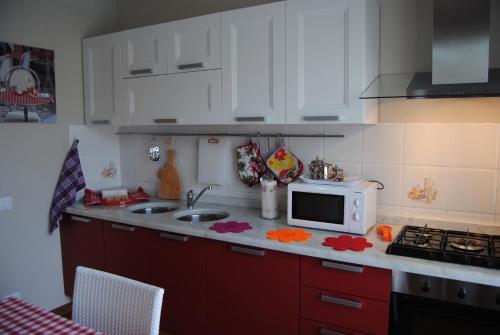 Cucina o angolo cottura di Casa Cenerentola