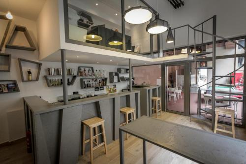 The lounge or bar area at Boutique Hostel Shappy