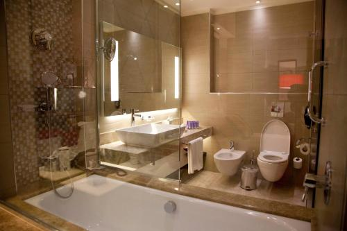 A bathroom at Grand Millennium Hotel Amman