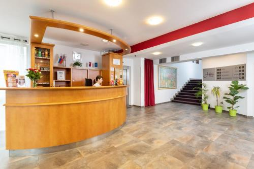 Lobby alebo recepcia v ubytovaní Hotel Plus