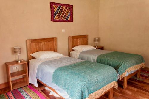 A bed or beds in a room at MAMA COYA