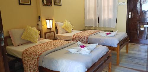 A bed or beds in a room at Harsidhi Haveli