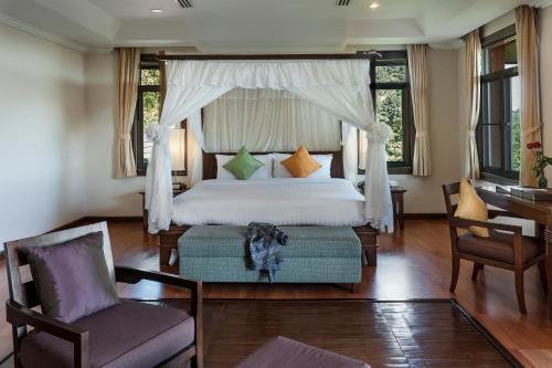 เตียงในห้องที่ คาทิลิยา เมาน์เทน รีสอร์ท แอนด์ สปา เชียงราย