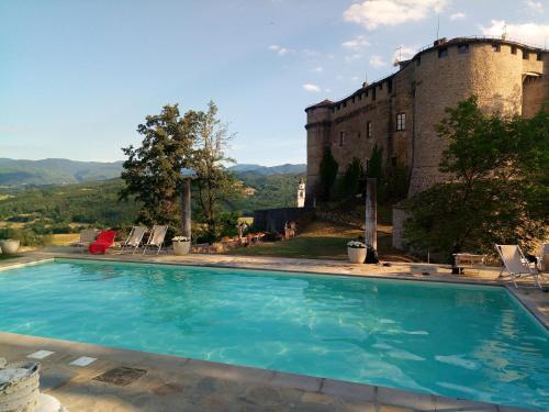 The swimming pool at or near Castello Di Compiano Hotel Relais Museum
