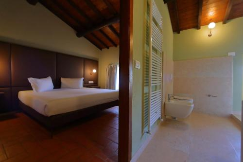 A bed or beds in a room at La Boheme Chambres
