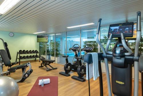 The fitness center and/or fitness facilities at Leonardo Royal Hotel Baden- Baden