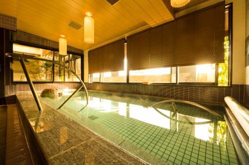 The swimming pool at or near Dormy Inn Premium Kyoto Ekimae Natural Hot Spring