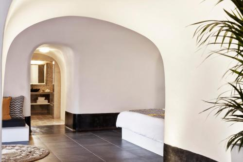 A bed or beds in a room at San Antonio - Small Luxury Hotels of the World