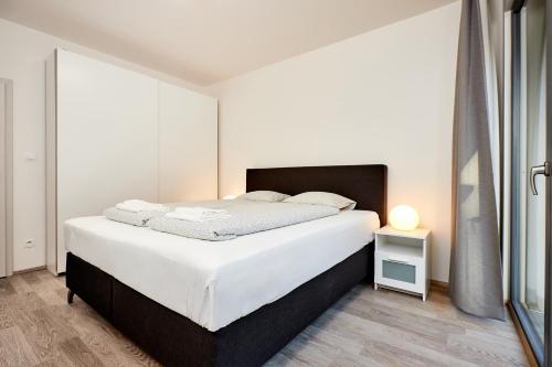 Letto o letti in una camera di Apartments Port Karolina