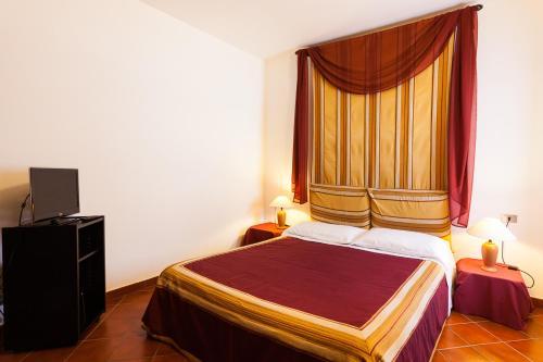 Letto o letti in una camera di Residenza Del Lago