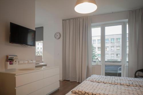Łóżko lub łóżka w pokoju w obiekcie StudioApart2 Elbląg
