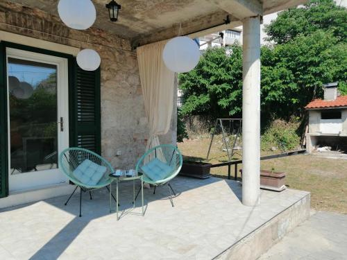 A patio or other outdoor area at Studio apartman Adris