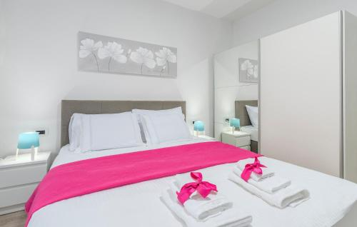 A bed or beds in a room at Apartments Vita