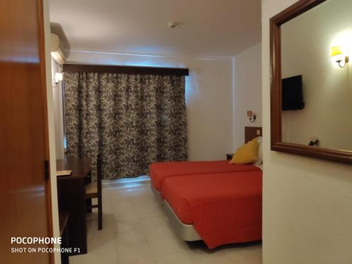 Uma área de estar em Hotel Alnacir