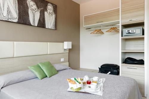 Letto o letti in una camera di Hotel Cristina