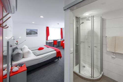A bathroom at BEST WESTERN PLUS Aalener Römerhotel a.W.L.