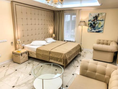 Кровать или кровати в номере Апарт-отель Кутузов