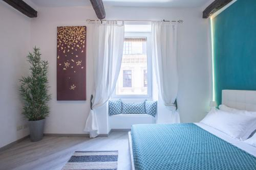 A bed or beds in a room at Sidus Suite