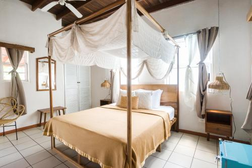A bed or beds in a room at Selina Manuel Antonio