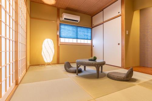 Bijou Suites Naniwaにあるシーティングエリア