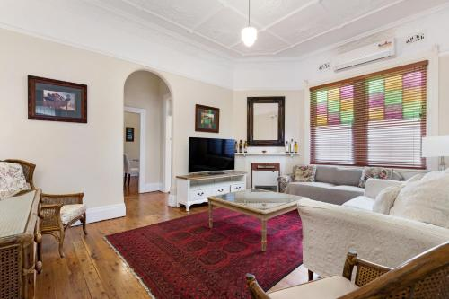A seating area at Drummoyne 3 Bedroom Home (62ALE)
