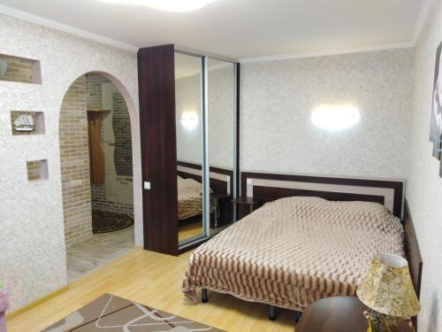 Кровать или кровати в номере Apartment na Lenina 8