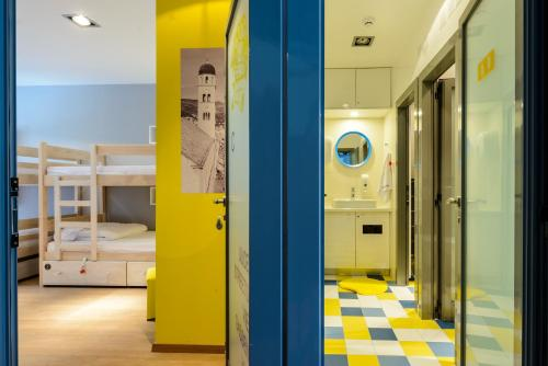 A bunk bed or bunk beds in a room at Hostel EuroAdria