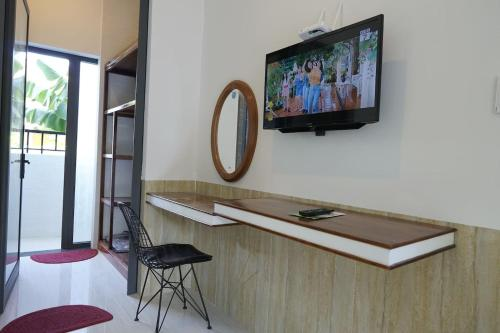 A television and/or entertainment center at Kha Nguyen Home