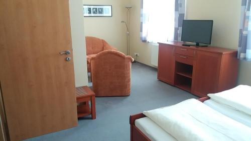 Телевизор и/или развлекательный центр в Hotel Harmonie
