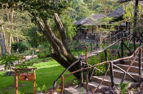 A garden outside Crater Lake Tented Camp And Game Sanctuary